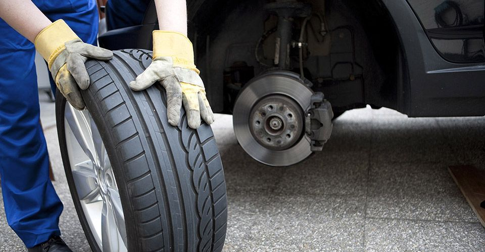 Auto Mechanic with Tire